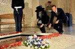 Prime Minister Tony Abbott and his wife Margie lay poppies on the Tomb of the Unknown Soldier at the Australian War Memorial during the national ANZAC Day service in Canberra, Monday, April 25, 2011.The service commemorated the 96th anniversary of Gallipoli.