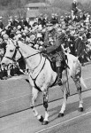 General Sir John Monash mounted on a dappled grey charger during an Anzac Day march, 25 April 1931